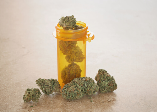 pill bottle filled with marijuana