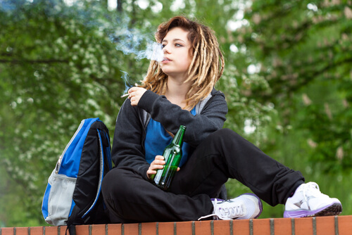 teenage girl smoking weed at school yard