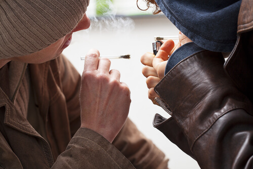 two teenagers smoking cannabis