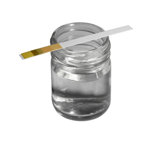 Glass with a liquid and control stick