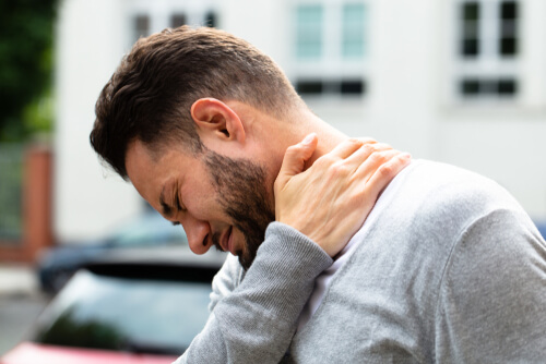Man Having Pain In His Neck