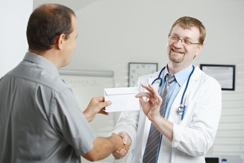 Patient is giving bribe to the doctor