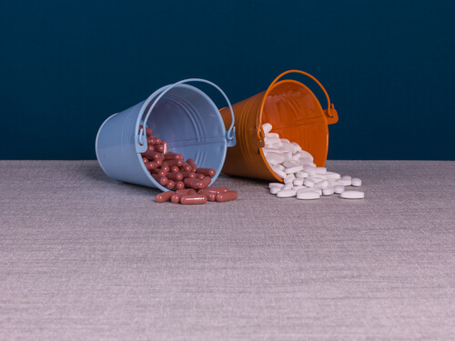 Baclofen pills in two buckets