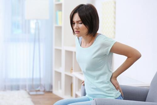 Woman is suffering from backache