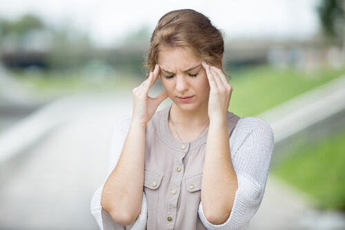 depressed woman with headache