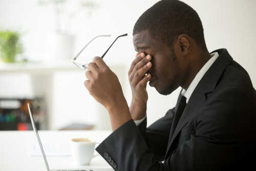 man with headache and dizziness