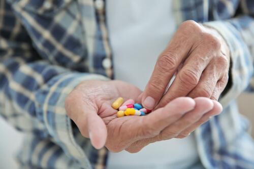 man taking different pills