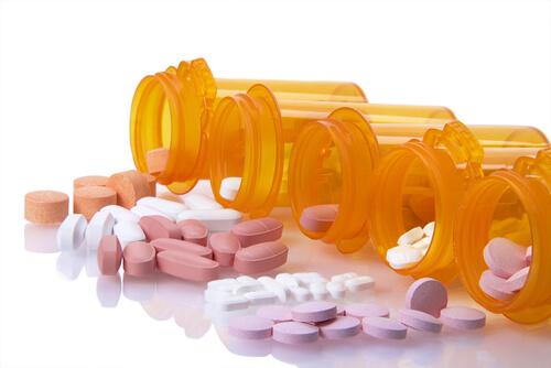 five botlles with different prescription pills
