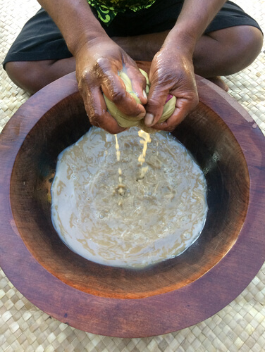 man making kava drink