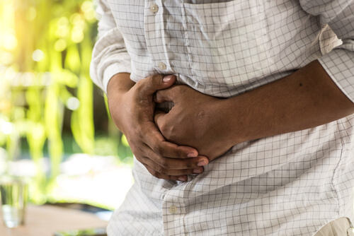 Black man is experiencing stomachache after meloxicam ingesting