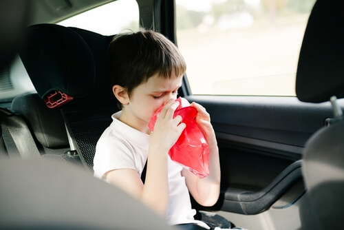 Child is suffering from motion sickness in the vehicle