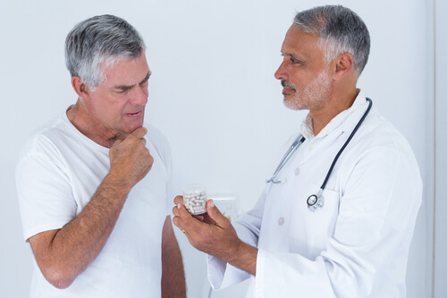Male doctor advising senior man