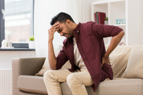 young man is suffering from backpain
