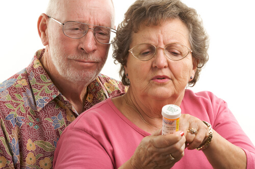 senior couple reading prescription on the bottle