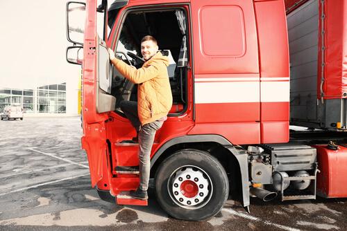 truck driver standing near his truck