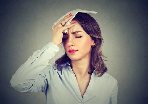 woman wipes sweat having benadryl withdrawal symptoms