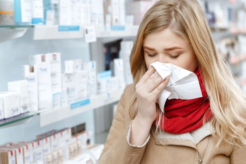 young woman choosing between zyrtec and benadryl for allergy