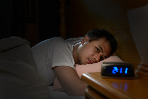 Depressed man suffering from insomnia from Lortab