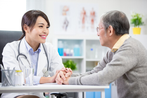 Female doctor consults elderly patient about wellbutrin ad weigh