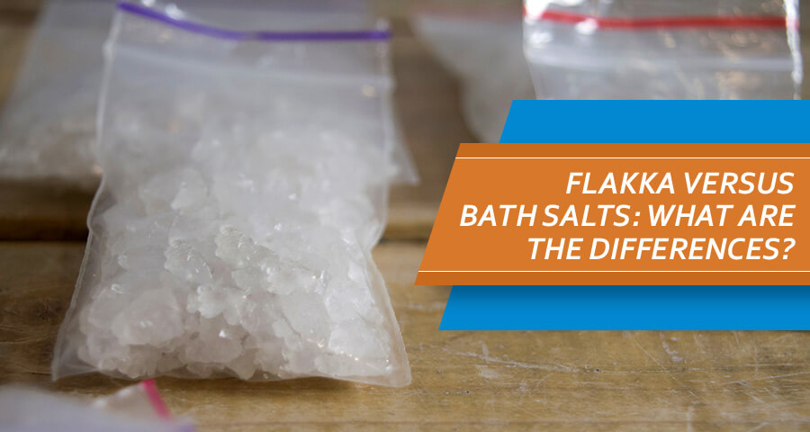 Bags with Flakka and Baths Salts drug on wooden table