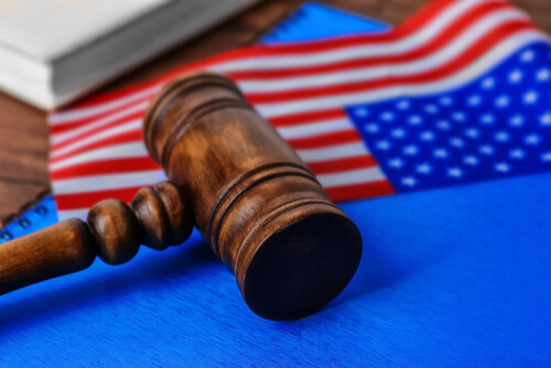 Notebook, gavel and American flag