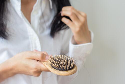 brush with long black hair loss