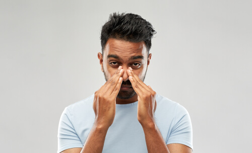 indian man rubbing nose after snorting bupropion
