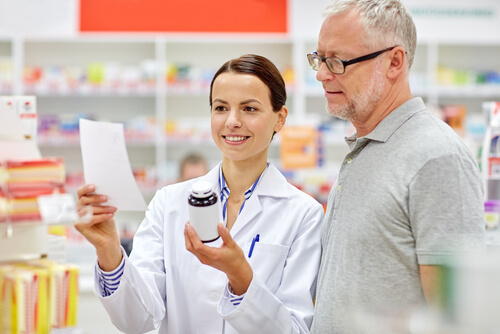 senior male customer buying wellbutrin with prescription