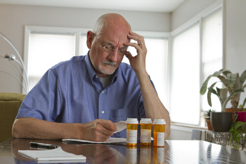 man reading a prescription information