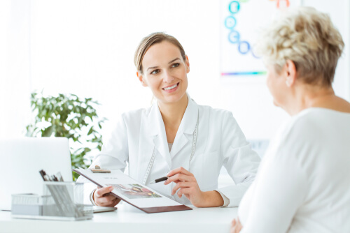 Doctor showing a healthy wellbutrin elimination plan to female patient