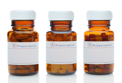 three brown medicine bottles filled with different bupropion pills