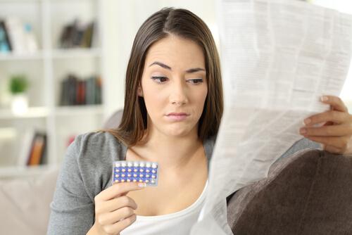 woman reading wellbutrin prescription