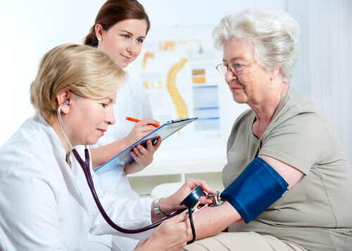 Female doctor measuring blood pressure after muscle relaxers intake