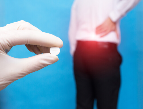 Doctor holds a muscle relaxer pill