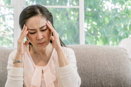 asian woman with migraine