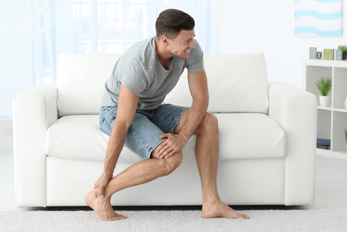 man suffering from leg pain