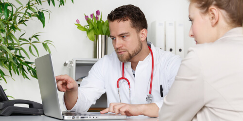 Doctor shows types of opioids on laptop