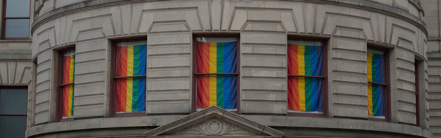 LGBTQ flags on building, horizontal