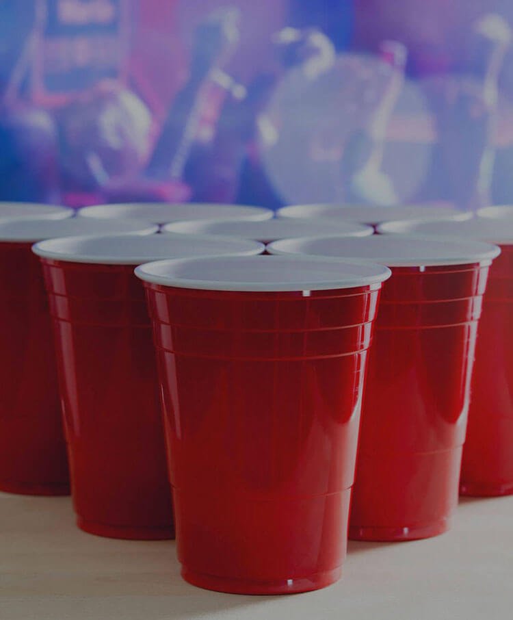 plastic cups for beerpong game and party on the background
