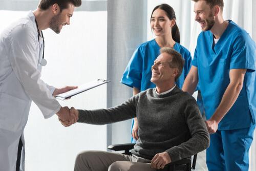 doctor giving handshake to patient