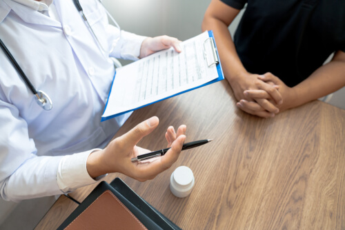 giving a consultation to a patient