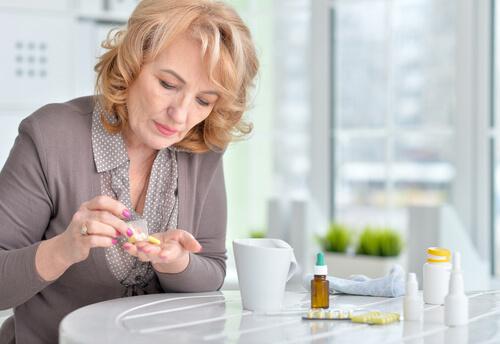 senior woman taking sleeping pills