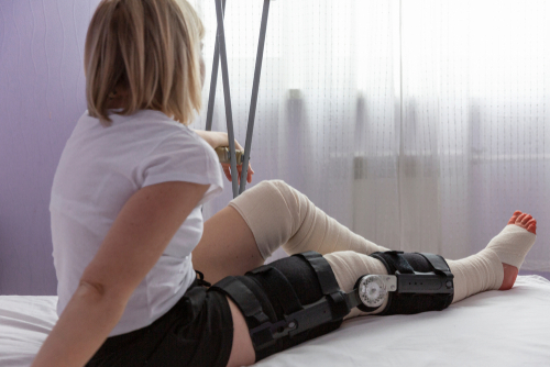 woman with an orthosis on the bed