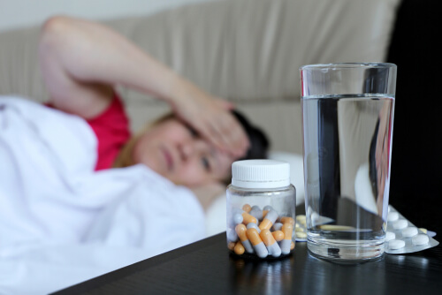 woman feeling sick due to sleeping pills overdose