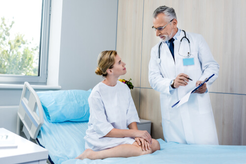 patient in the bed talking with a doctor
