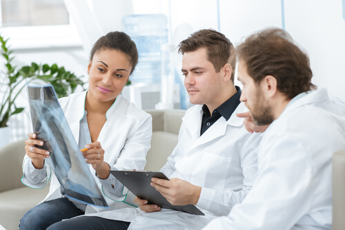 doctor showing TMS results to her colleagues