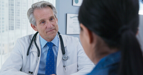 doctor consults a woman on substance abuse treatment