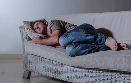 sick man lying on the sofa