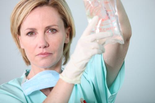 nurse holding an IV bag