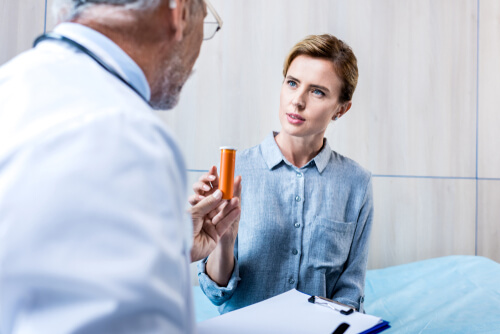 doctor taks with patient about prescribed drugs